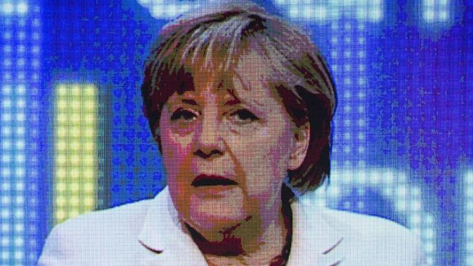 "German Chancellor Angela Merkel attends a discussion panel on ""making Europe strong"" during the Europe forum conference, organized by German public-broadcasting institution WDR, in Berlin, Germany, Thursday, May 16, 2013. (AP Photo/Gero Breloer)"