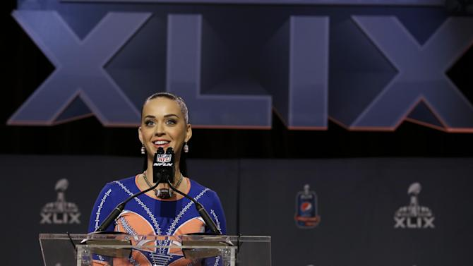 Katy Perry answers questions at a halftime news conference for NFL Super Bowl XLIX football game Thursday, Jan. 29, 2015, in Phoenix. (AP Photo/Morry Gash)