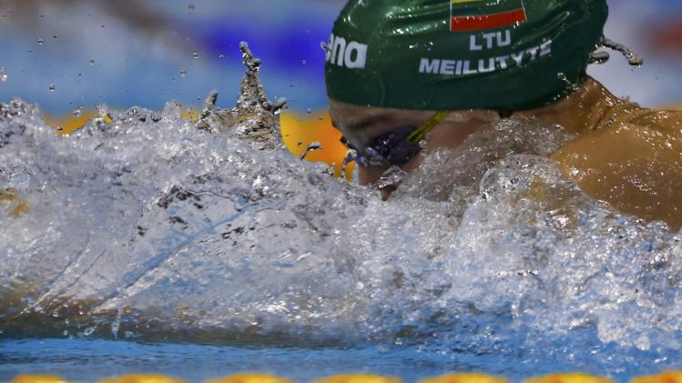 Meilutyte of Lithuania swims in the women's 50m breaststroke heats at the European Swimming Championships in Berlin