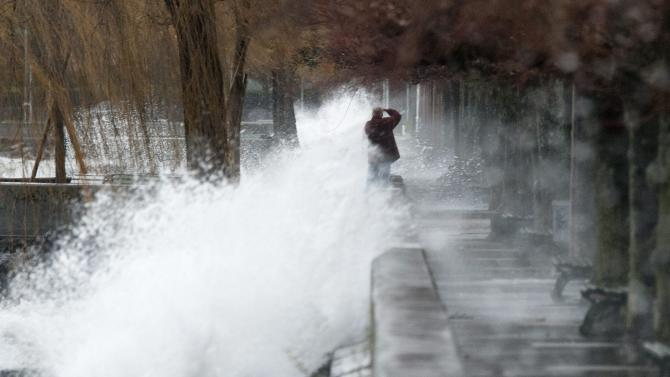 Storm hits Swiss with winds, rain, snow