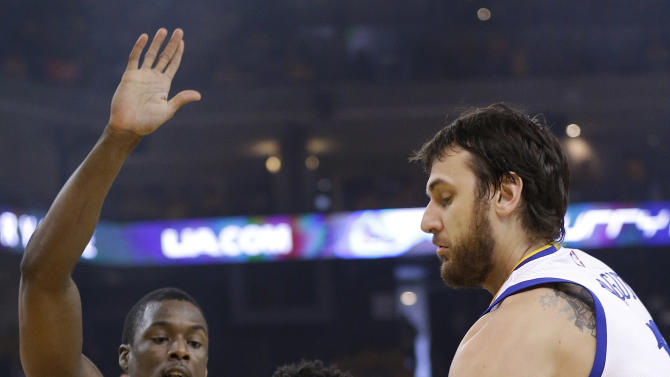Memphis Grizzlies guard Courtney Lee, center, dribbles against Golden State Warriors forward Harrison Barnes, left, and center Andrew Bogut during the first half of Game 1 in a second-round NBA playoff basketball series in Oakland, Calif., Sunday, May 3, 2015. (AP Photo/Marcio Jose Sanchez)
