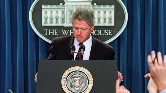 "FILE – In this Jan. 3, 1996 file photo President Clinton ponders a reporters question during a  White House briefing room news conference about the federal budget impasse as the Republican House held firm, rejecting a move to end the 19-day partial government shutdown. The president condemned the defiance and continued impasse,  and called it then ""an unnatural disaster.""   (AP Photo/Wilfredo Lee, File)"