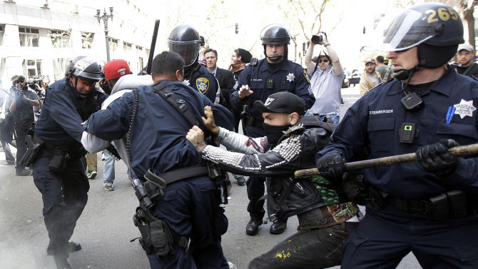 Police confront demonstrators during May Day protests on Tuesday, May 1, 2012 in Oakland, Calif.  Hundreds of activists across the U.S. joined the worldwide May Day protests on Tuesday, with Occupy Wall Street members in several cities leading demonstrations and in some cases clashing with police.  (AP Photo/Marcio Jose Sanchez)