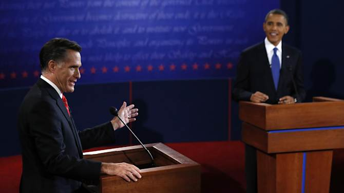 President Barack Obama listens as Republican presidential nominee Mitt Romney answers a question during the first presidential debate at the University of Denver, Wednesday, Oct. 3, 2012, in Denver. (AP Photo/Rick Wilking, Pool)