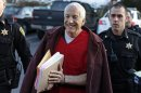 FILE - In this Jan. 10, 2013 file photo, former Penn State University assistant football coach Jerry Sandusky, center, arrives at the Centre County Courthouse for a post-sentence motion in Bellefonte, Pa. Sandusky lost a bid for a new trial Wednesday, Jan. 30, 2013 when Judge John Cleland rejected his argument that his lawyers were not given enough time to prepare for the three-week proceeding that ended with a 45-count guilty verdict. Sandusky is serving a 30- to 60-year prison sentence after being convicted in June of 45 counts of child sexual abuse. (AP Photo/Gene J. Puskar, File)