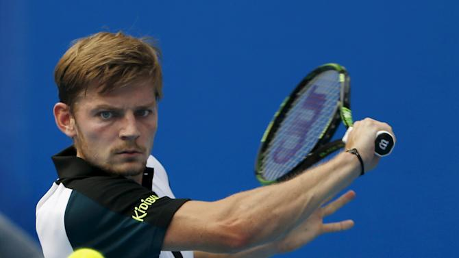 David Goffin of Belgium hits a return against Andreas Seppi of Italy during a men's singles match at the China Open tennis tournament in Beijing