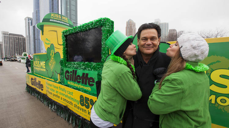 "IMAGE DISTRIBUTED FOR GILLETTE -Football Hall of Fame star Dan ""Danimal"" Hampton declares ""Kiss Me, I'm Smooth Shaven!"" at the Gillette float with brand ambassadors during the St. Patrick's Day Parade in Chicago, on Saturday, March 16, 2013. (Photo by Barry Brecheisen/Invision for Gillette/AP Images)"