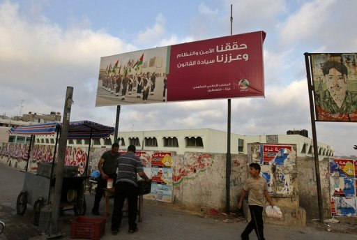 Banners advertising the Hamas government in Gaza City. A bomb killed a militant in the northern part of the city Friday
