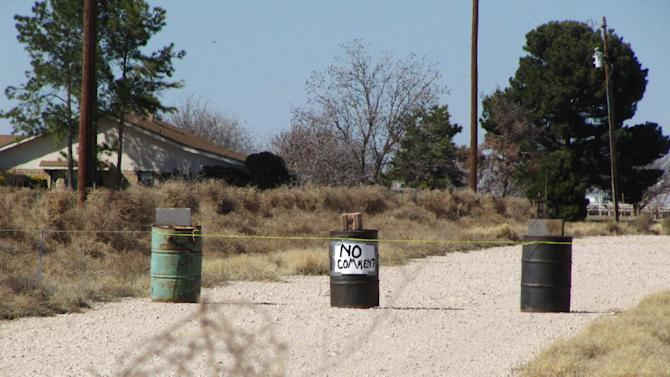 In this March 1, 2013 file photo, the driveway to the Shatto family home, rear left, is seen in Gardendale, Texas. In the Jan. 21, 2013 tape released Thursday, April 4, 2013 Laura Shatto tells a 911 operator that Max Shatto isn't breathing. Later she is heard pleading for help as she tries to revive her dying 3-year-old adopted Russian son while EMS personnel race to her rural West Texas home. (AP Photo/Betsy Blaney)