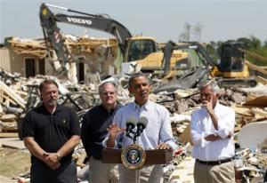 Amid the wreckage, U.S. President Barack Obama speaks as he visits the tornado devastated town of Vilonia