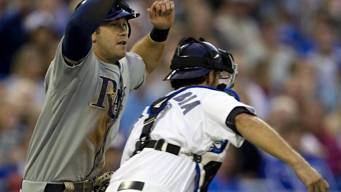 Toronto Blue Jays catcher J.P. Arencibia runs down and tags Tampa Bay Rays' Evan Longoria during the third inning of a baseball game in Toronto, Monday, Aug. 29, 2011. (AP Photo/The Canadian Press, Frank Gunn)