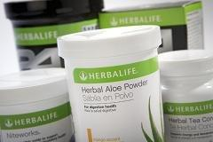 Herbalife tops estimates, raises full-year outlook