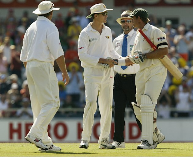 Matthew Hayden of Australia is congratulated by Zimbvawe players