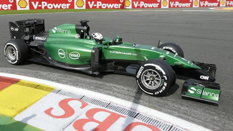 Caterham driver Kamui Kobayashi of Japan steers his car into the hairpin, during the first practice session ahead of Sunday's Belgian Formula One Grand Prix in Spa-Francorchamps, Belgium, Friday, Aug. 22, 2014. (AP Photo/Yves Logghe)