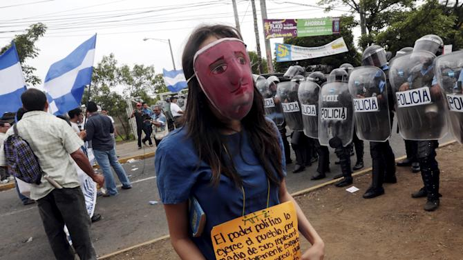 An opposition supporter takes part in a protest in Managua