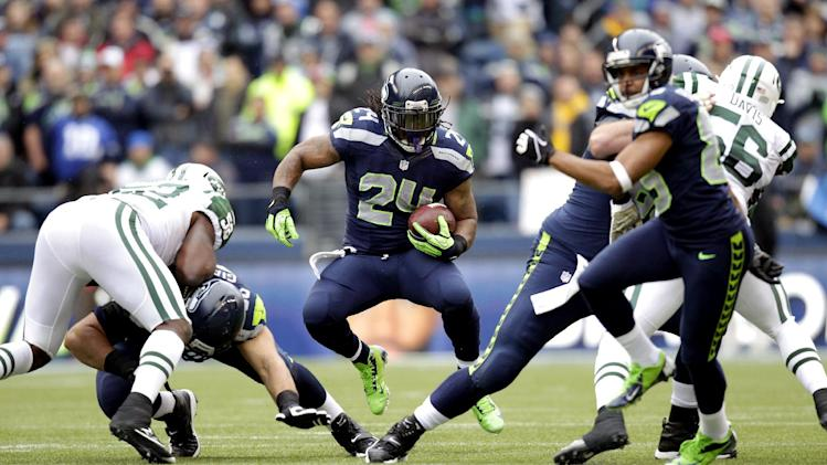 Seattle Seahawks' Marshawn Lynch (24) rushes against the New York Jets during the first half of an NFL football game, Sunday, Nov. 11, 2012, in Seattle. (AP Photo/Stephen Brashear)