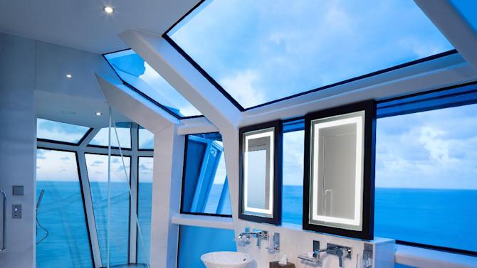 This undated photo provided by Celebrity Cruises shows the Reflection Suite bathroom on Celebrity's new Reflection ship. The all-glass shower extends over the edge of the ship with a wraparound verandah and special glass so you can see out, but not in. It's one of a number of new features and attractions on ships as the 2013 cruise season gets under way. (AP Photo/Celebrity Cruises)