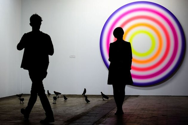 A man (L) and a woman look at a piece at the Art Basel Hong Kong fair in Hong Kong on May 22, 2013