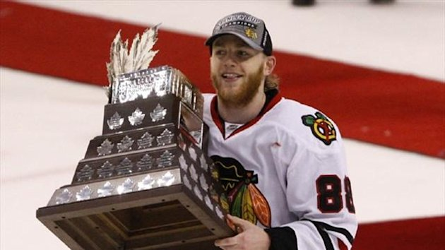 Chicago Blackhawks' Patrick Kane carries the Conn Smythe trophy (Reuters)