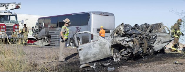 A wrong-way pickup truck driver was killed on Interstate 10 Tuesday, Nov. 20, 2012 when the vehicle collided head-on with a tour bus, forcing the closure of all westbound lanes near Casa Grande, Ariz.