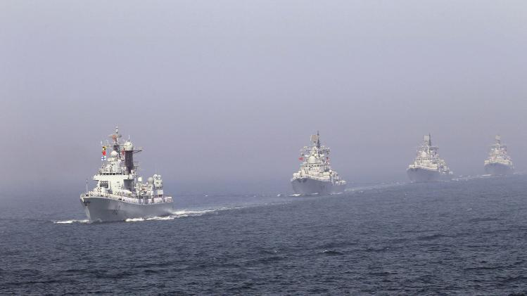 File photo of Chinese missile destroyers navigating during the fleet's review of the China-Russia joint naval exercise in the Yellow Sea