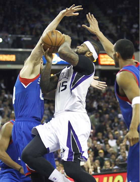 Sacramento Kings center DeMarcus Cousins (15) drives to the basket against Philadelphia 76ers defender Spencer Hawes during the second half of an NBA basketball game in Sacramento, Calif., on Thursday