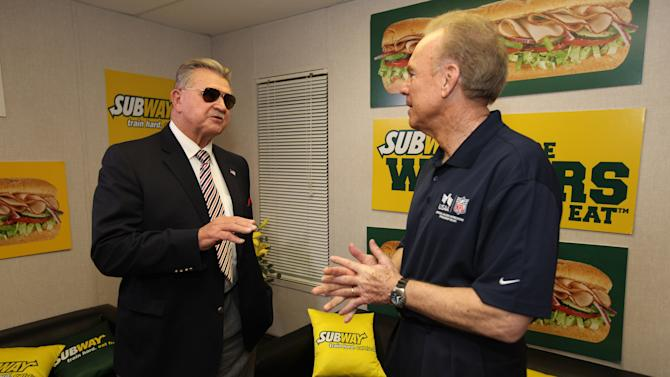 IMAGE DISTRIBUTED FOR SUBWAY - ESPN analyst Mike Ditka and Hall of Famer Roger Staubach stop by the Subway Fresh Take Green Room before heading on the set of ESPN's Mike & Mike in the Morning for Super Week in New Orleans on Friday, Feb. 1, 2013. (Photo by Barry Brecheisen/Invision for SUBWAY/AP Images)