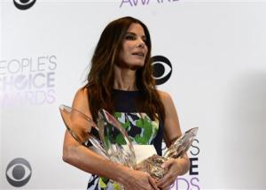 Sandra Bullock poses with her awards at the 2014 People's Choice Awards in Los Angeles
