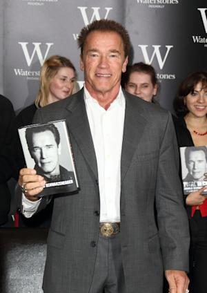 Arnold Schwarzenegger meets fans as he signs copies of his book 'Total Recall: My Unbelievably True Life Story' at Waterstone's, Piccadilly in London on October 15, 2012 -- Getty Premium