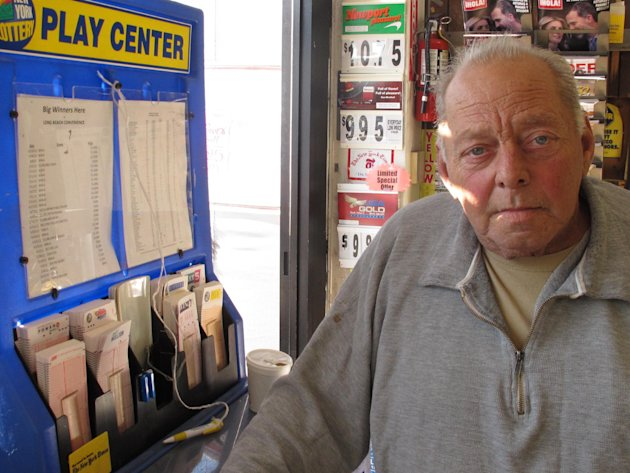 Raymond Parker mulls what he might do with the winning Powerball jackpot inside a stationery store  in Long Beach, N.Y. on Monday, Nov. 26, 2012. The 67-year-old Long Beach resident, who's car was des