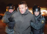 File picture shows police arresting Russian protest leader Alexei Navalny in Moscow's Pushkinskaya Square, on March 5. Navalny called Thursday for a nation-wide rally in early September after his release from jail for disobeying police during a recent protest against Vladimir Putin