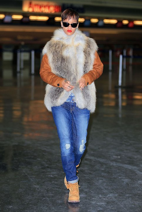 Celebrities in winter woolies: Rihanna wrapped up warm in this furry gilet. Copyright [Splash]