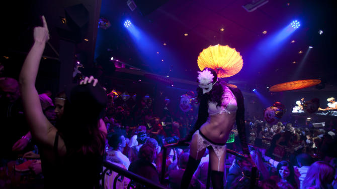 In this March. 9, 2012 photo, Russian-speaking Israelis dance to Russian pop beats at the Soho nightclub in Tel Aviv. The club caters to the Russian-speaking immigrant community, featuring hired dancers and extravagant decorations rarely seen in informal Israel. (AP Photo/Oded Balilty)