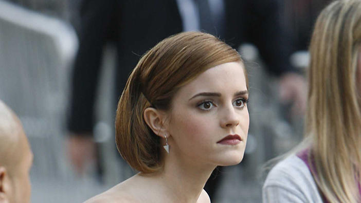 Emma Watson adjusts herself as she arrives at the Premiere of 'This is the End'