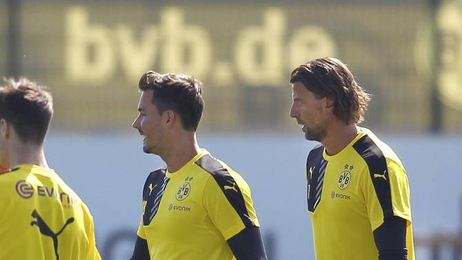 Borussia Dortmund's Weidenfeller and Buerki attend the first training session for the new soccer season in Dortmund