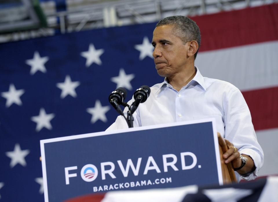 President Barack Obama pauses while speaking at a campaign event at Green Run High School in Virginia Beach, Va., Friday, July 13, 2012. Obama is spending the day in Virginia campaigning. (AP Photo/Susan Walsh)