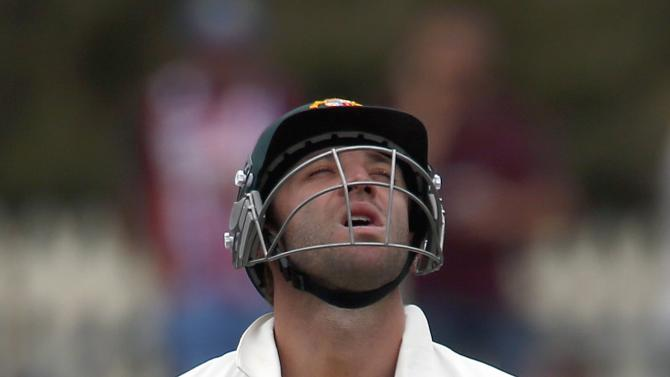 File photo of Australia's Phil Hughes reacting after being dismissed in the first cricket test against Sri Lanka at Bellerive Oval in Hobart