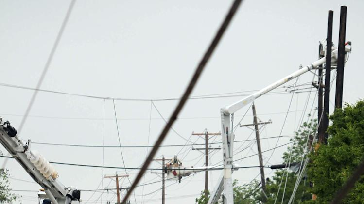 Power lines damaged by Wednesday's tornado litter the streets in Cleburne, Texas on Thursday, May 16, 2013. Ten tornadoes touched down in several small communities in Texas overnight, leaving at least six people dead, dozens injured and hundreds homeless. Emergency responders were still searching for missing people Thursday afternoon. (AP Photo/Ron Russek II)