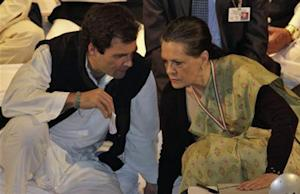 Gandhi a lawmaker speaks to Sonia Gandhi, who is his mother and India's ruling Congress party chief, during the Indian National Congress meeting in Jaipur
