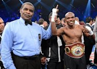 "Timothy Bradley (R) has his hand raised in victory after defeating Manny Pacquiao by split decision to win the WBO welterweight title on June 9. ""He's a strong puncher, he rocked me a couple of times in the fight, but I held my ground and fought to the end. This is boxing,"" Bradley said"