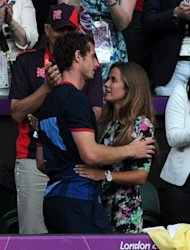 Andy Murray (L) embraces his girlfriend Kim Sears after beating Switzerland&#39;s Roger Federer in their men&#39;s tennis singles final at the London Olympics on August 5. Before heading to the Toronto Masters, Murray plans to enjoy a long night&#39;s celebration with Sears, his family and backroom staff