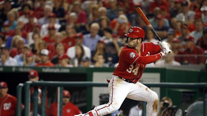 Washington Nationals right fielder Bryce Harper (34) bats during a baseball game against the San Francisco Giants at Nationals Park, Sunday, July 5, 2015, in Washington. (AP Photo/Alex Brandon)