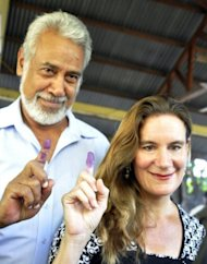 National Congress for Timorese Reconstruction (CNRT) leader Xanana Gusmao (L) and his wife Kirsty Sword show their inked fingers as they cast their votes at a polling station during the East Timor's parliamentary elections in Dili, on July 7. Gusmao's party looked set to win the elections, a key test for the young and fragile democracy, preliminary results showed on Sunday