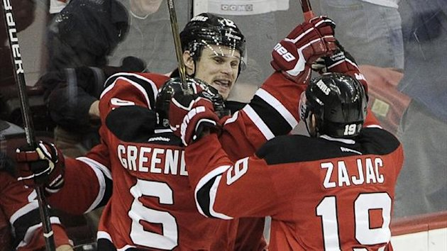 2011-12 NHL New Jersey Devils' Alexei Ponikarovsky (C) celebrates with teammate Andy Greene (6) and Travis Zajac (19)