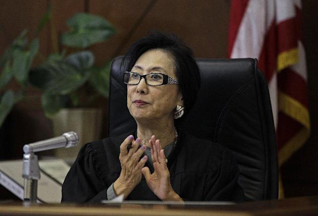 Judge Lillian Sing applauds a defendant on the bench of the Community Court Tuesday, Sept. 18, 2012, in San Francisco. While its been difficult for researchers to determine cost savings by the courts, new studies suggest the courts are helping stem crime. An evaluation of Washington, D.C.s community court by the Westat research firm found this summer that defendants who successfully completed diversion programs from 2007 to 2009 were half as likely to reoffend as similar defendants in a traditional court. (AP Photo/Ben Margot)