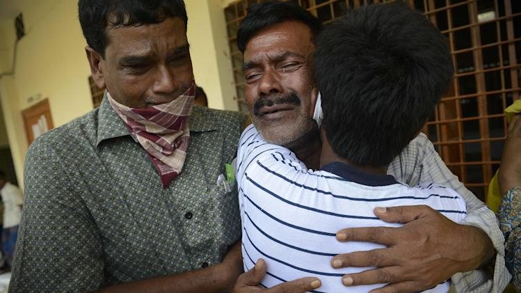 A Bangladeshi man cries after identifying the body of a relative at a makeshift morgue near the site of a garment factory building that collapsed in Savar near Dhaka, Bangladesh, Wednesday May 8, 2013. Dozens of bodies recovered Wednesday from the building were so decomposed they were being sent to a lab for DNA identification, police said, as the death toll from Bangladesh's worst industrial disaster topped 800. (AP Photo/Ismail Ferdous)
