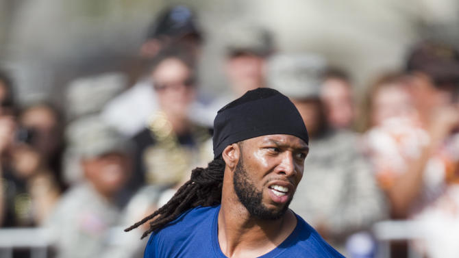 IMAGE DISTRIBUTED FOR USAA - NFC and Arizona Cardinals wide receiver Larry Fitzgerald (11) catches a pass during during NFL Pro Bowl Practice at Joint Base Pearl Harbor Hickam, Thursday, Jan. 24. 2013 in Honolulu.  (Marco Garcia/AP Images for USAA)