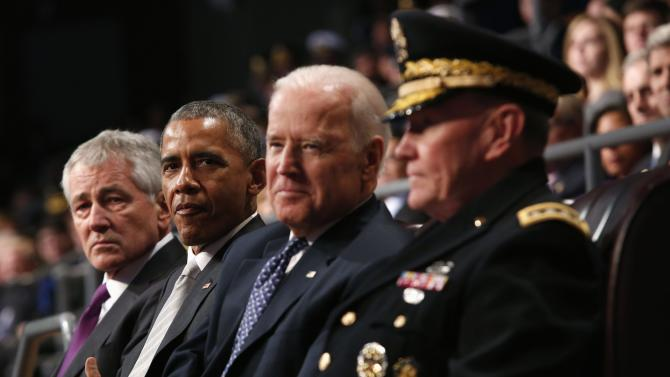Outgoing Defense Secretary Hagel, U.S. President Obama, Vice President Biden and Chairman of the Joint Chiefs of Staff Gen. Dempsey attend a farewell ceremony for Hagel, in Virginia