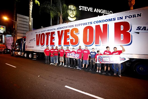IMAGE DISTRIBUTED FOR AIDS Healthcare Foundation - Supporters of Vote Yes on B in Los Angeles, the condoms in porn measure on the November ballot led by AIDS Healthcare Foundation, hand out voter info