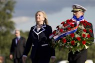 U.S. Secretary of State Hillary Rodham Clinton and U.S. Navy Vice Adm. Harry B. Harris Jr. pay their respects during a flower-laying at the Monument to the Heroic Defenders of Leningrad, Thursday, June 28, 2012, in St. Petersburg, Russia. (AP Photo/Haraz N. Ghanbari, Pool)